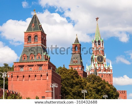 Moscow cityscape - Konstantino-Eleninskaya, Nabatnaya and Spasskaya Towers of Moscow Kremlin on Red Square - stock photo