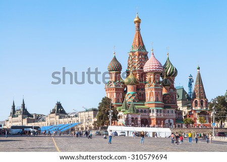 Moscow cityscape - Saint Basil Cathedral and Vasilevsky Descent of Red Square of Moscow Kremlin in summer afternoon - stock photo