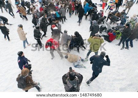 MOSCOW - DEC 9: A lot of people are having fun throwing snow at each other in Central Park of Culture and Rest named after Maxim Gorky December 9, 2012, Moscow, Russia. Park was established in 1928. - stock photo