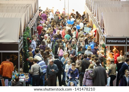 MOSCOW - DEC 1: Crowd at sixth gastronomic festival Foodshow Christmas at Gostiny Dvor, on Dec 1, 2012 in Moscow, Russia. - stock photo
