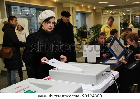 MOSCOW - DEC 4 - Parliamentary elections in Russia: an unidentified woman votes on december 4, 2011 in Moscow - stock photo