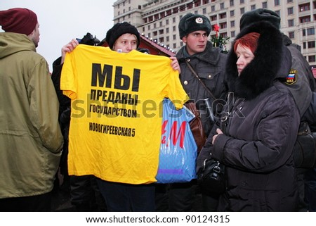 MOSCOW - DEC 4 - Parliamentary elections in Russia: unidentified woman protest against unfair elections on december 4, 2011 in Moscow - stock photo