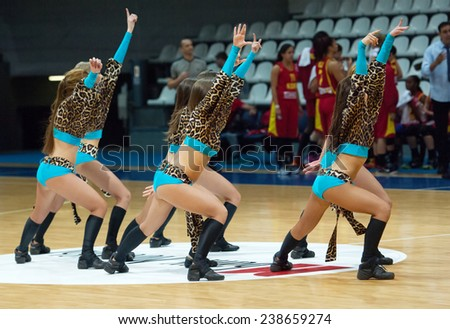 MOSCOW - DECEMBER 4, 2014: Cheerleaders dancing during the International Europe bascketball league match Dynamo Moscow vs Maccabi Ashdod Israel in sport palace Krilatskoe, Moscow, Russia - stock photo