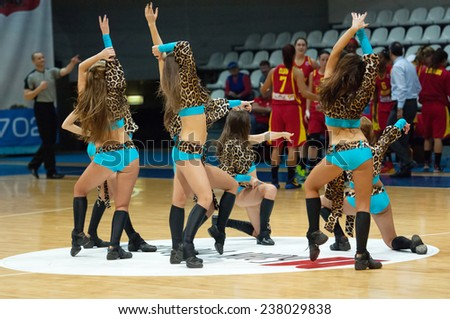 MOSCOW - DECEMBER 4, 2014: Cheerleaders dancing during the International Europe bascketball match Dynamo Moscow vs Maccabi Ashdod Israel in sport palace Krilatskoe, Moscow, Russia. Dynamo loss 59:67 - stock photo