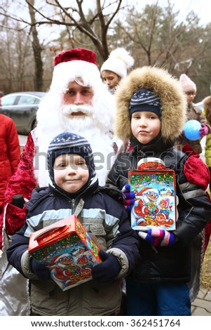 MOSCOW, DECEMBER 26, 2015: Childen participate in Christmas animated event with Father Frost and other fairy tale characters. Thay play games and get presents in Moscow, December 26, 2015 Russia