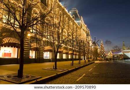 MOSCOW - DECEMBER 27, 2013: Christmas tree and building of GUM (State Universal Shop) on Red square. - stock photo