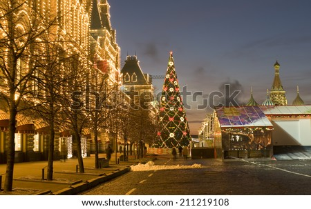 MOSCOW - DECEMBER 27, 2013: Christmas tree on Red square and illuminated building of GUM (State Universal Shop).  - stock photo