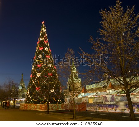 MOSCOW - DECEMBER 27, 2013: Christmas tree on Red Square, St. Basils Intercession cathedral and Spasskaya tower of Kremlin fortress. - stock photo