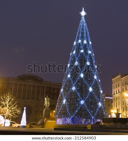 MOSCOW - DECEMBER 28, 2013: Christmas tree on Tverskaya street and building of Moscow Government.