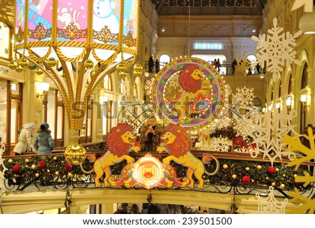 MOSCOW - DECEMBER 21: Drawn lions, snowflakes and Christmas illuminations in GUM store on December 21, 2014 in Moscow.