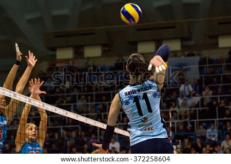 MOSCOW - DECEMBER 2: E. Gamova-Mukasey (11) attack on a game Dynamo MSK vs Dynamo KZN on Russian National wemen Volleyball tournament on December 2, in Moscow, Russia, 2015 - stock photo