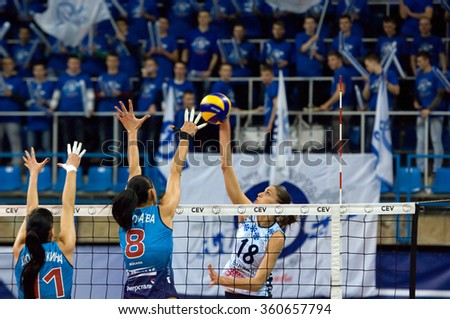 MOSCOW - DECEMBER 2: E. Vasileva (18) attack on a game Dynamo MSK vs Dynamo KZN on Russian National women Volleyball tournament on December 2, in Moscow, Russia, 2015 - stock photo
