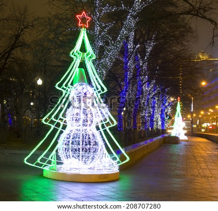 MOSCOW - DECEMBER 29, 2013: electric decoration on New Arbat street for Christmas and New Year holidays - electirc snowman and electric Christmas trees, illumination on trees. - stock photo