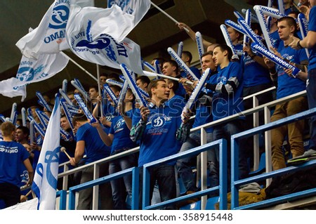 MOSCOW - DECEMBER 2: Fans of Dynamo team scan on a game Dynamo MSK vs Dynamo KZN on Russian National women Volleyball tournament on December 2, in Moscow, Russia, 2015 - stock photo