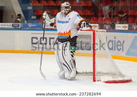 MOSCOW - DECEMBER 3: Goalkeeper Shtepanek Y. (33) resting during the game CSKA vs Severstal on Russian KHL premier hockey league Championship on December 3, 2014, in Moscow, Russia. CSKA won 9:1 - stock photo