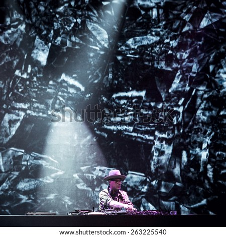 MOSCOW - 5 DECEMBER,2014 : James Lavelle aka Unkle playing DJ set in nightclub.Famous dj play on stage of night club.DJ music show on scene