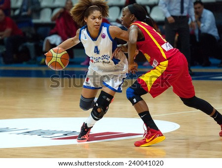 MOSCOW - DECEMBER 4, 2014: Katerina Keyru (4) dribble on the International Europe bascketball league match Dynamo Moscow vs Maccabi Ashdod Israel in Moscow, Russia. Dynamo loss 59:67 - stock photo