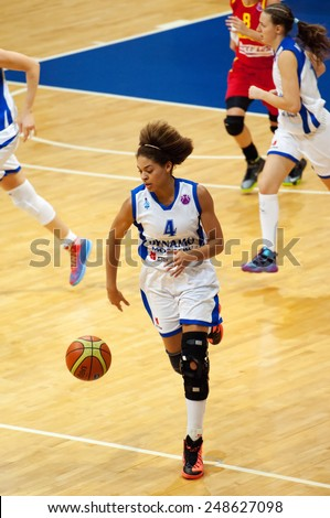 MOSCOW - DECEMBER 4, 2014: Katerina Keyru (4) dribble on the International Europe bascketball league match Dynamo Moscow vs Maccabi Ashdod in sport palace Krilatskoe, Moscow, Russia. Dynamo loss 59:67 - stock photo