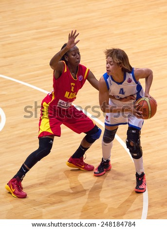 MOSCOW - DECEMBER 4, 2014: Katerina Keyru (4) fight during the International Europe bascketball league match Dynamo Moscow vs Maccabi Ashdod Israel in sport palace Krilatskoe, Moscow, Russia - stock photo
