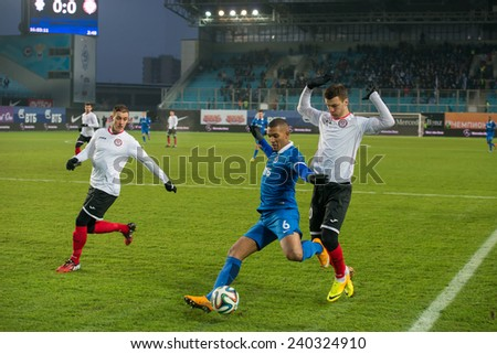 MOSCOW - DECEMBER 7: Midfielder William Vanker (6) on the football match on Russian Premier League Dynamo (Moscow) vs Amkar (Perm) on December 7, 2014, in Moscow, Russia. Dynamo won 5: 1 - stock photo