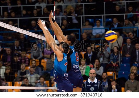 MOSCOW - DECEMBER 2: N. Obmochaeva (8) and E. Lyubushkina (11) in action on a game Dynamo MSK vs Dynamo KZN on Russian National wemen Volleyball tournament on December 2, in Moscow, Russia, 2015 - stock photo