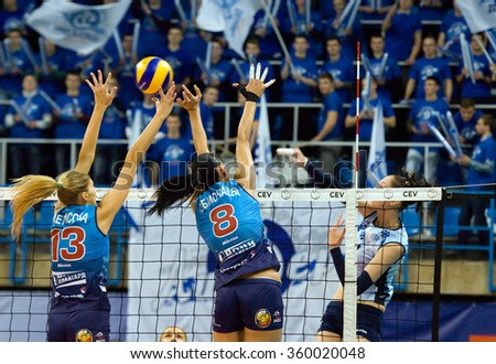 MOSCOW - DECEMBER 2: N. Obmochaeva (8) and I. Fetisova (13) defend on a game Dynamo MSK vs Dynamo KZN on Russian National women Volleyball tournament on December 2, in Moscow, Russia, 2015 - stock photo