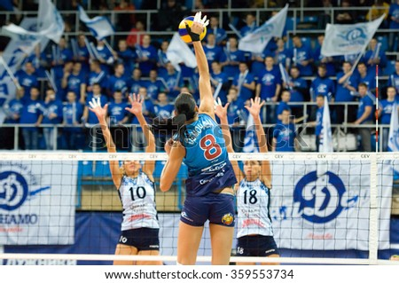 MOSCOW - DECEMBER 2: N. Obmochaeva (8) attack on a game Dynamo MSK vs Dynamo KZN on Russian National women Volleyball tournament on December 2, in Moscow, Russia, 2015 - stock photo