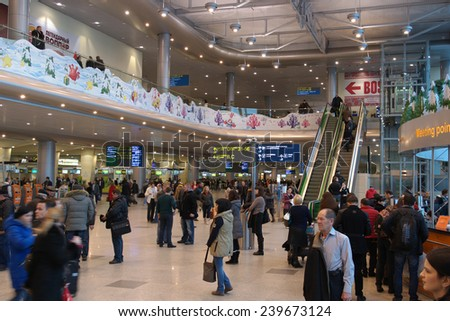 MOSCOW - DECEMBER 16, 2014: People in the hall of the airport Domodedovo December 16, 2014 in Moscow. Domodedovo airport - the largest and modern airport of Russia