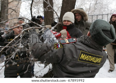 MOSCOW - DECEMBER 27: Russian police detain a supporter of Yukos oil company chief executive officer Mikhail Khodorkovsky during a rally outside the court December 27, 2010 in Moscow, Russia.