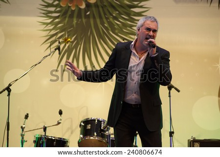 MOSCOW - DECEMBER 26: Russian singer V. Meladze on a scene sing a song on a New Year concert on December 26, 2013 in Moscow, Russia - stock photo