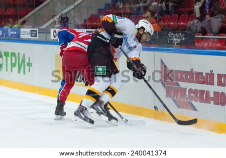 MOSCOW - DECEMBER 3: Stasenko N. (5) fights on game CSKA vs Severstal on Russian KHL premier hockey league Championship on December 3, 2014, in Moscow, Russia. CSKA won 9:1 - stock photo