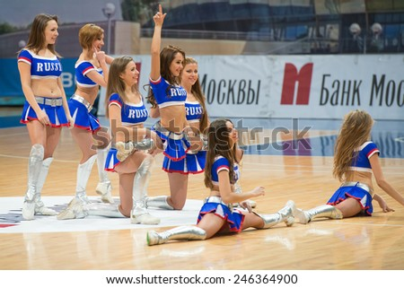 MOSCOW - DECEMBER 4, 2014: Unidentified cheerleaders dans on the International Europe bascketball league match Dynamo Moscow vs Maccabi Ashdod Israel in sport palace Krilatskoe, Moscow, Russia.  - stock photo