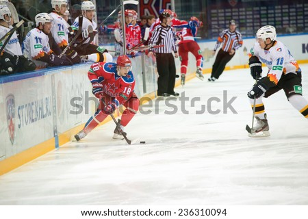 MOSCOW - DECEMBER 3: Unidentified hockey player on game CSKA vs Severstal on Russian KHL premier hockey league Championship on December 3, 2014, in Moscow, Russia. CSKA won 9:1 - stock photo