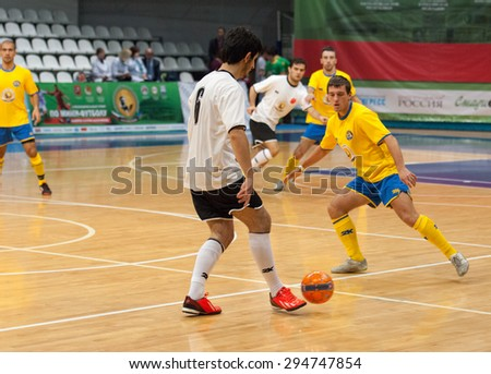 MOSCOW - DECEMBER 13: Unidentified players of Turkish diaspora team with ball on Minifootball tournament in memoriam Tofik Bahramov on  December 13, 2014, in Krilatskoe stadium, Moscow, Russia
