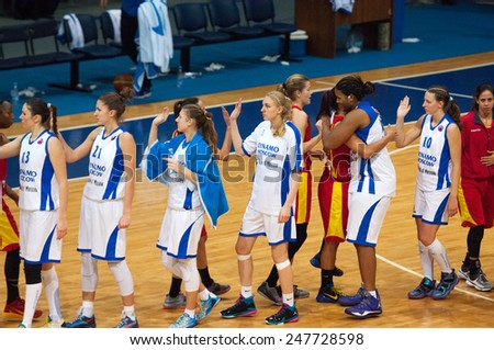 MOSCOW - DECEMBER 4, 2014: Unidentified players shakes hands just after International Europe bascketball league match Dynamo Moscow vs Maccabi Ashdod Israel in sport palace Krilatskoe, Moscow, Russia - stock photo