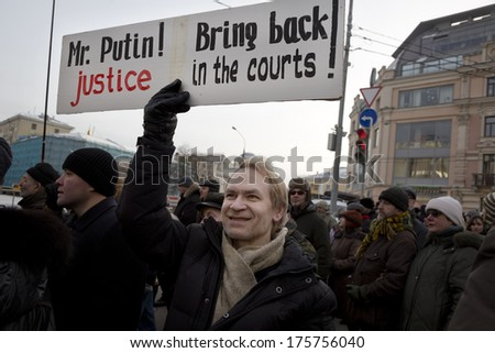 MOSCOW - FEB 2:Anti-Putin protesters march through Moscow February 2,2014,Russia.Several thousand protesters have marched through central Moscow to call for the release of 20 people who were arrested  - stock photo