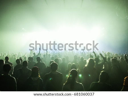 MOSCOW-20 FEBRUARY,2015: Crowded dancefloor in nightclub.Big live music show in night club.People have fun on concert.Big crowd on sold out festival.Rave party people on dance floor.Techno music party