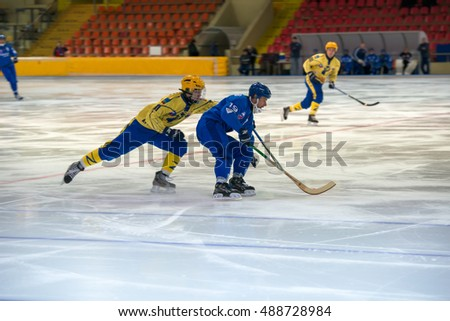 MOSCOW - FEBRUARY 26, 2016: Dmitry Savelyev 19 in action during the Russian bandy league game Dynamo Moscow vs Zorky Krasnogorsk in sport palace Krilatskoe, Moscow, Russia. Dynamo won 9: 2