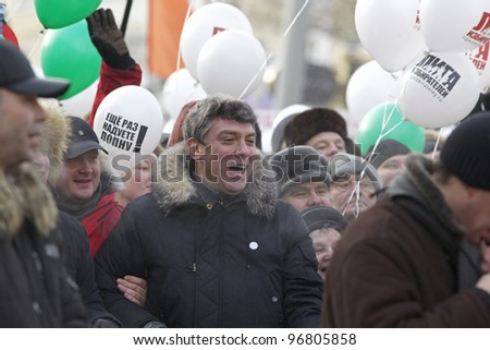 MOSCOW - FEBRUARY 4: Russian opposition leader Boris Nemtsov at march through Moscow on February 4, 2012 in Moscow, Russia. Up to 120,000 Russian anti-government protesters demand political reform. - stock photo