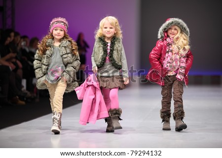 MOSCOW - FEBRUARY 22: Unidentified child models wear fashions by Snowimage and walk the catwalk in Collection Premiere Moscow, an international fashion fair for Eastern Europe, on February 22, 2011 in Moscow, Russia. - stock photo