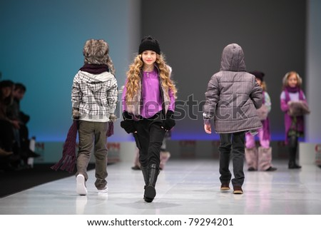 MOSCOW - FEBRUARY 22: Unidentified child models wear fashions from Snowimage and walk the catwalk in Collection Premiere Moscow, main platform of fashion industry in Eastern Europe, on February 22, 2011 in Moscow, Russia - stock photo