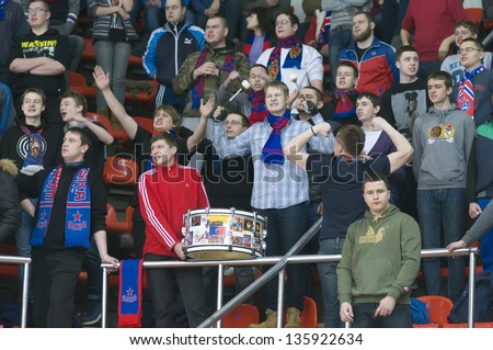 MOSCOW - FEBRUARY 20: Unidentified fans support their team CSKA Moscow in the Hockey match CSKA-LEV PRAHA in sports palace CSKA on February 30, 2013 in Moscow, Russia - stock photo