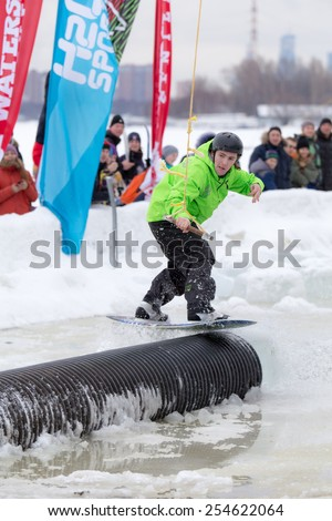 MOSCOW - FEBRUARY 07:  wakeboarder performing a stunt at Ice Wakeboarding contest in Moscow,  February 07, 2015, Moscow, Russia  - stock photo