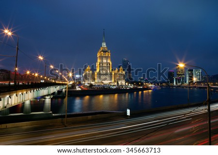 "Moscow. High-rise building on the banks of the Moscow river in the evening. The building spectacularly situated at the steepest bend of the Moscow river, where it is encircled by the loop ""high-rise""."