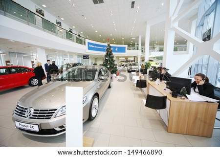MOSCOW - JAN 11: Cars and a consultants on workplaces in Volkswagen Varshavka Center on January 11, Moscow, Russia. The official dealer of Volkswagen Varshavka Center opened September 10, 2010 - stock photo
