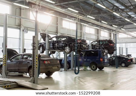 MOSCOW - JAN 11: Hall of the station for maintenance vehicles with cars prepared for the check and repair in Varshavka Center on January 11, 2013, Moscow, Russia - stock photo