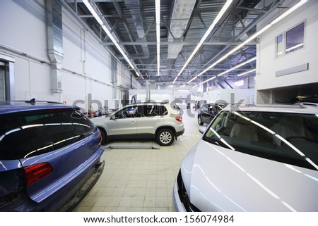 MOSCOW - JAN 11: View between two cars on the premises in service stations in the Volkswagen Varshavka Center on January 11, 2013, Moscow, Russia - stock photo