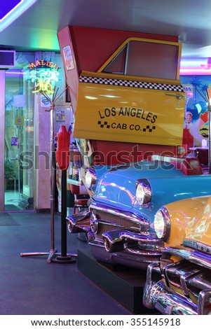 MOSCOW - JAN 21, 2015: Vintage cars in the interior American restaurant Beverly Hills Diner - stock photo