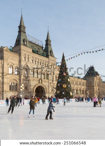 Moscow - January 16, 2015: Adults and children ride on skating rink for the Christmas holidays on the Red Square and decorated Christmas tree Jan. 16, 2015, Moscow, Russia - stock photo