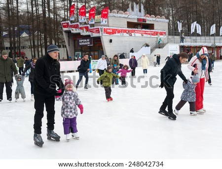 MOSCOW - JANUARY 17: Adults and children skating in Sokolniki Park on January 17, 2015 in Moscow. - stock photo